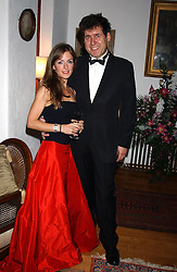 GUY LUCAS and his wife ANDREA at a charity dinner hosted by Jennie Hallam-Peel to promote the London Debutante Season held at her home Somerhill, Rowdean Crescent, Brighton on 12th September 2004.