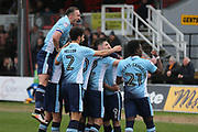 Blackpool FC Mark Cullen (9) scores from the spot and celebrates with his team mates 0-2 second half during the EFL Sky Bet League 2 match between Newport County and Blackpool at Rodney Parade, Newport, Wales on 18 March 2017. Photo by Gary Learmonth.