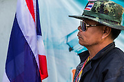 "01 FEBRUARY 2014 - BANGKOK, THAILAND: An anti-government security guard blocks the Din Daeng polling place in central Bangkok. Thais went to the polls in a ""snap election"" Sunday called in December after Prime Minister Yingluck Shinawatra dissolved the parliament in the face of large anti-government protests in Bangkok. The anti-government opposition, led by the People's Democratic Reform Committee (PDRC), called for a boycott of the election and threatened to disrupt voting. Many polling places in Bangkok were closed by protestors who blocked access to the polls or distribution of ballots. The result of the election are likely to be contested in the Thai Constitutional Court and may be invalidated because there won't be quorum in the Thai parliament.    PHOTO BY JACK KURTZ"