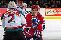KELOWNA, CANADA - FEBRUARY 17: Taylor Ross #16 of the Spokane Chiefs checks James Hilsendager #2 of the Kelowna Rockets during first period on February 17, 2017 at Prospera Place in Kelowna, British Columbia, Canada.  (Photo by Marissa Baecker/Shoot the Breeze)  *** Local Caption ***