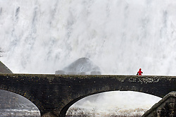 © Licensed to London News Pictures. 27/01/2016. Powys,  UK. Water rages over the Caban Coch dam at the Elan Valley Reservoirs near Rhayader, Powys, Wales, after very heavy rainfall during the last three days. Birmingham is supplied by these Welsh reservoirs on a gravity feed. Photo credit: Graham M. Lawrence/LNP