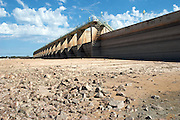 Lake Buchanan, Tx, Buchanan Dam, completed in 1937, is two miles in width and is the most upstream of multiple dams creating the Highland Lakes north of Austin, Texas. Drought conditions in 2006 provided a rare view of the upstream base of the dam.