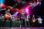 ORLANDO, FL - APRIL 3:  John Stamos (L) performs with Mike Love and Bruce Johnston (L) of the Beach Boys at Universal Studios on April 3, 2010, in Orlando, Florida. The Beach Boys were performing as part of the Mardi Gras concert series. (Photo by Matt Stroshane/Getty Images) ***Local Caption*** Mike Love;John Stamos;Bruce Johnston