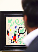 Visitor admires painting by Joan Miró at the Landau Gallery at Art Basel Miami Beach 2008