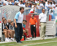 16 June 2007: Guatemala head coac Hernan Dario Gomez (foreground) and Canada head coach Stephen Hart (right, rear). The Canada Men's National team defeated the Guatemala Men's National Team 3-0 at Gillette Stadium in Foxboro, Massachusetts in a 2007 CONCACAF Gold Cup quarterfinal.