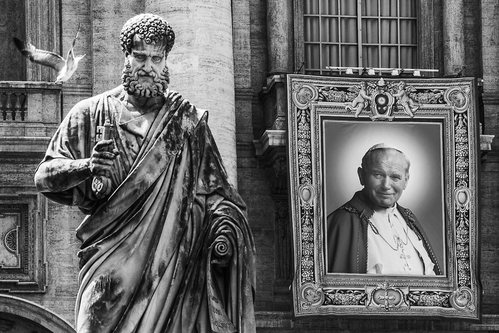 The tapestry depicting John Paul II is seen in  St. Peter's Square one day before the canonoization of John Paul II and John XXIII at the Vatican. The double canonisation of two of modern-day Catholicism's most influential figures will be presided over by Pope Francis and will be attended by his elderly predecessor Benedict XVI, bringing two living pontiffs together to celebrate two deceased predecessors.