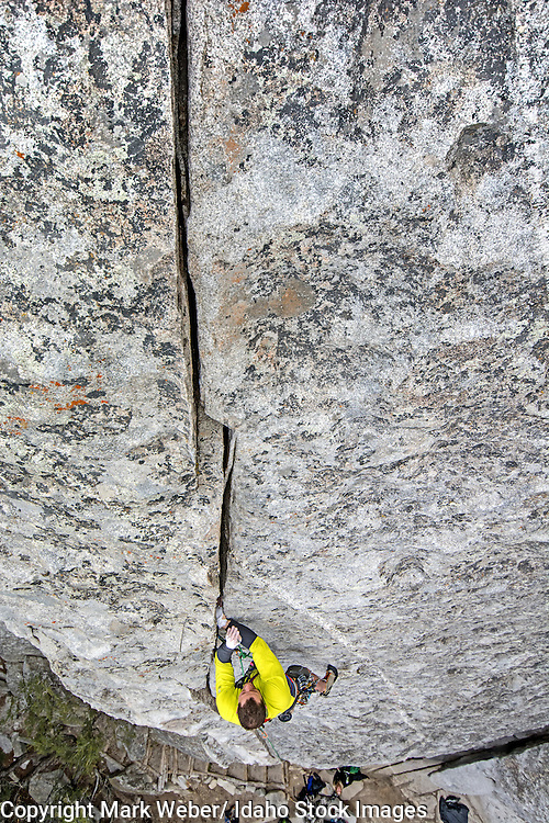 Elijah Weber rock climbing a route called Bloody Fingers which is rated 5,10 and located on Super Hits Wall at the City Of Rocks National Reserve near the town of Almo in southern Idaho