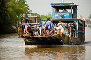 12 MARCH 2006 - CAI BE, TIEN GIANG, VIETNAM: A passenger ferry carries a load to Cai Be in the Mekong River delta. The Mekong is the lifeblood of southern Vietnam. It is the country's rice bowl and has enabled Vietnam to become the second leading rice exporting country in the world (after Thailand). The Mekong delta also carries commercial and passenger traffic throughout the region.  Photo by Jack Kurtz