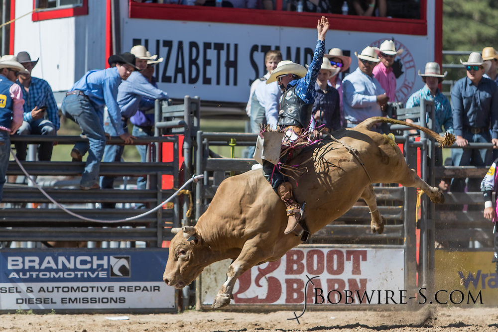 Bull rider Kyle Gardner rides Salt River Rodeo's 02 Man Down in the first performance of the Elizabeth Stampede on Saturday, June 2, 2018.