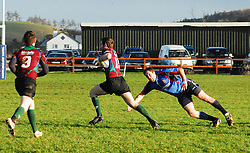 Westport's Danny O'Toole attempts a tap tackle on Corrib's Thomas Lee during the entertaining junior league match in Carrowholly on sunday...Pic Conor McKeown
