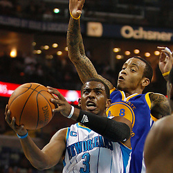 January 5, 2011; New Orleans, LA, USA; New Orleans Hornets point guard Chris Paul (3) shoots over Golden State Warriors shooting guard Monta Ellis (8) during the first half at the New Orleans Arena.   Mandatory Credit: Derick E. Hingle