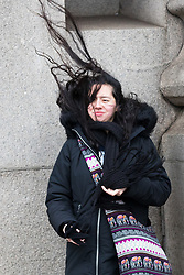 © Licensed to London News Pictures. 08/02/2019. London, UK.  A womans hair is blown in a gust of wind as she crosses Tower Bridge during wet and windy weather. Storm Erik is the first named storm of 2019 with gale force winds and wet weather affecting most of the UK today. Photo credit: Vickie Flores/LNP
