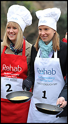 Sky news Sophy Ridge and Tracey Crouch MP  takes part in the MP's and Lords race against political Journalist in the Rehab Parliamentary Pancake Shrove Tuesday race a charity event which sees MPs and Lords joined by media types in a race to the finish. Victoria Tower Gardens, Westminster, Tuesday February 12, 2013. Photo By Andrew Parsons / i-Images