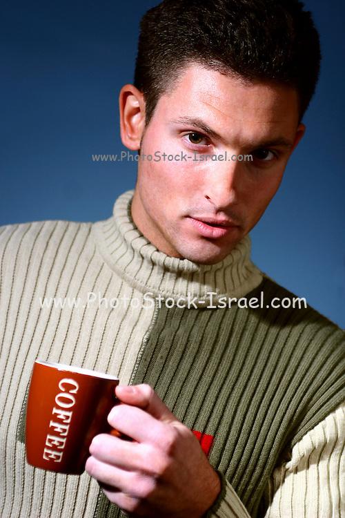 Male model drinking coffee portrait, studio