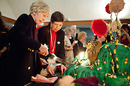 Audrey Geisel cuts a cake fashioned after the Dr. Suess book The Lorax, while Chancellor Maryanne Fox looks on during the celebration for the late author Theodore Geisel's 107th birthday, March 3, 2011.