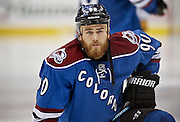 SHOT 3/28/15 8:51:17 PM - The Colorado Avalanche's Ryan O'Reilly #90 stretches during a break in the action against the Buffalo Sabres in their regular season NHL game at the Pepsi Center in Denver, Co. The Avalanche won the game 5-3. (Photo by Marc Piscotty / © 2015)