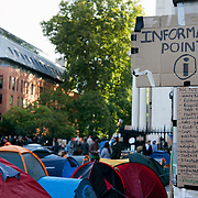 Information Point, - both for visitors and media but also for camping activists to keep up with what is needed to be done nad what has been agreed in various meetings. Day three of the occupation - and the first Monday.  The Occupy London Stock Exchange movement was formed in London in solidarity with the US based Occupy Wall Street. The movements are a respons and in anger to what is seen by many as corporate greed and a failed banking system being bailed out by the public, - which in return are suffering austerity measures to make up for the billions of lost money. The movement occupied the St Paul's Square in the City of London Sat Oct 15 after it failed to secure and occupy Pator Noster Square and the Stock Exchnage itself.