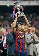 FC Barcelona's Carles Puyol with the champion trophy of the Supercup of Spain.August 23 2009.