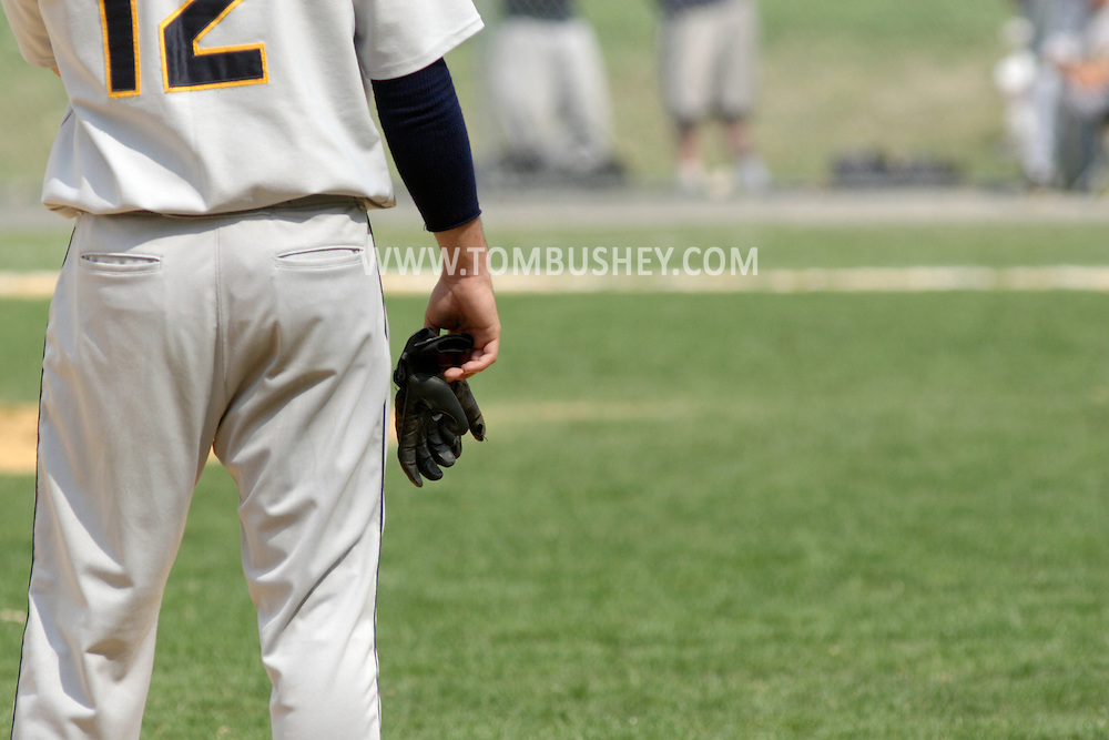 Middletown, NY - A Dutchess Community College baserunner holds his batting gloves in his hand during a Region XV baseball game against SUNY Orange on April 26, 2008.