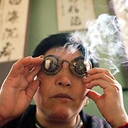 Burning herbal balls cures eye malfunction. . .Photo taken March 2000