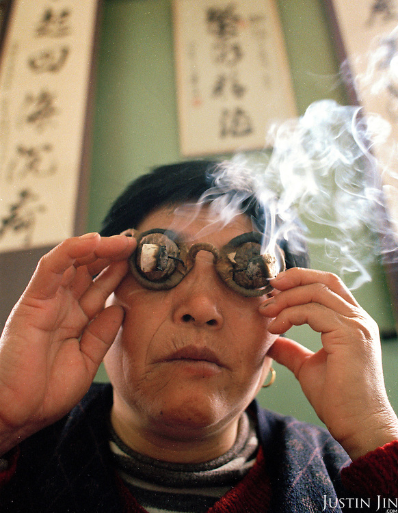 Burning herbal balls cures eye malfunction. . .Photo taken March 2000