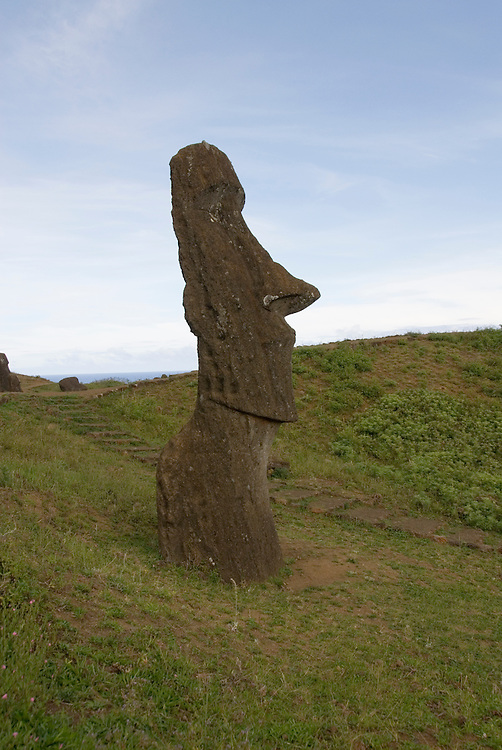 Chile, Easter Island: Sculptures at the quarry Rano Raraku where all the large sculptures were carved..Photo #: ch256-32710.Photo copyright Lee Foster www.fostertravel.com lee@fostertravel.com 510-549-2202
