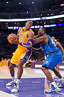 30 October 2012: Center (12) Dwight Howard of the Los Angeles Lakers turns to shoot while being guarded by (42) Elton Brand of the Dallas Mavericks during the second half of the Mavericks 99-91 victory over the Lakers at the STAPLES Center in Los Angeles, CA.
