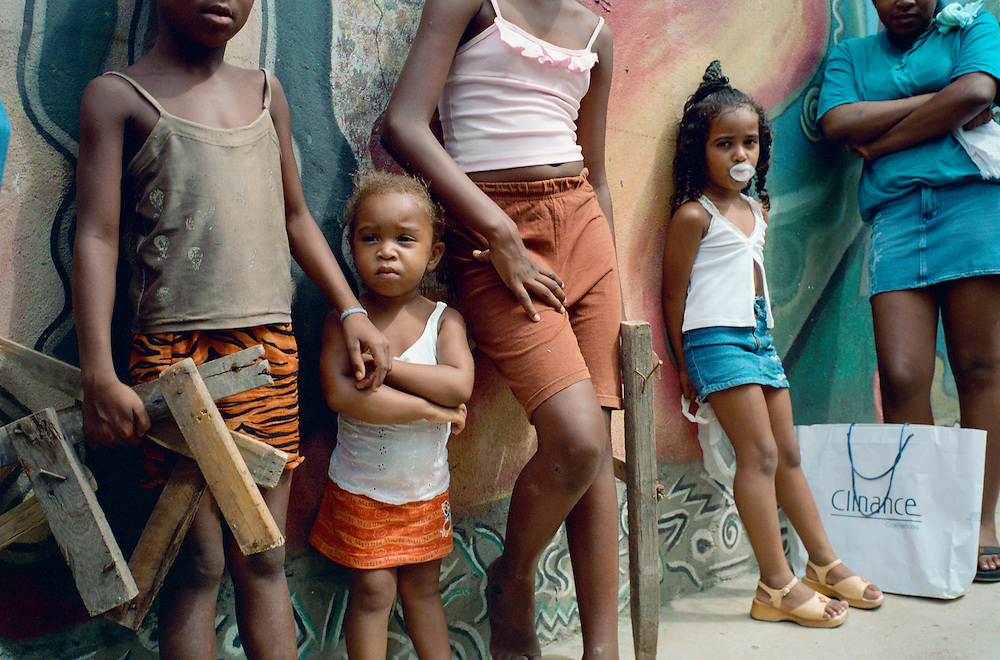 A gathering near the Afro Reggae Centre. Most people in the favela stress how the transformation undergone by the children has positively impacted the whole of the community. Rio de Janerio, Brazil. 2001