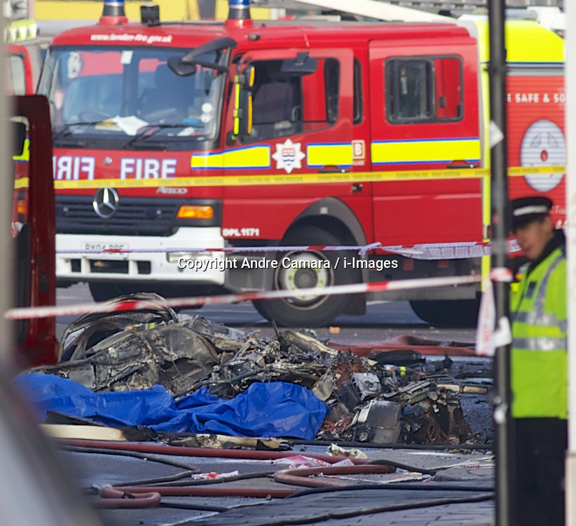 Helicopter crash in Vauxhall, London, UK. January 16, 2013. Smouldering wreckage from the scene. Photo by Andre Camara / i-Images.
