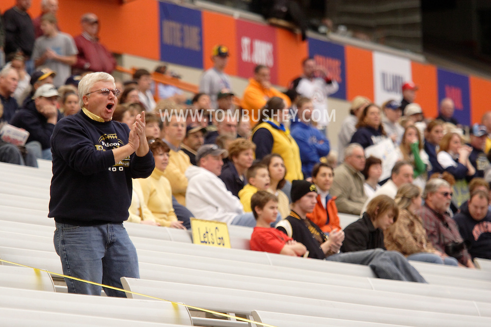 Syracuse, N.Y. - A Falconer High School football fan cheers for his team during the state Class D championship game against Dobbs Ferry at the Carrier Dome on Nov. 25, 2006. ©Tom Bushey
