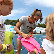 August 16, 2014, New Haven, CT:<br /> Andrea Petkovic signs autographs during a tennis clinic in the AETNA FitZone as part of Kids Day on day three of the 2014 Connecticut Open at the Yale University Tennis Center in New Haven, Connecticut Sunday, August 17, 2014.<br /> (Photo by Billie Weiss/Connecticut Open)