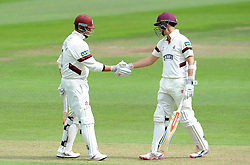 Somerset's Marcus Trescothick and Tom Cooper shake hands after sharing a stand of 108. - Photo mandatory by-line: Harry Trump/JMP - Mobile: 07966 386802 - 21/08/15 - SPORT - CRICKET - LV County Championship Division One - Day One - Somerset v Worcestershire - The County Ground, Taunton, England.