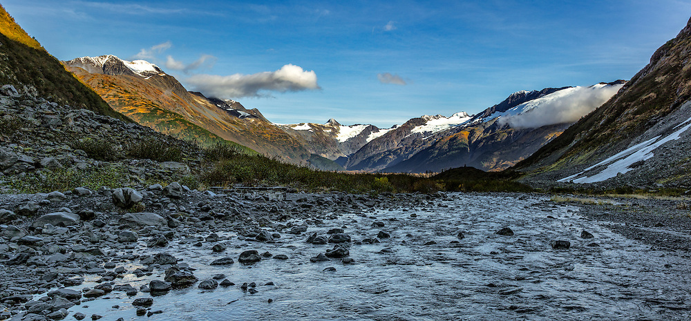 Alaska.  Panorama of Bear Valley north of Portage Lake with the headwaters of Byron Creek in the foreground just below Byron Glacier in September.