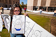 "07 FEBRUARY 2011 - PHOENIX, AZ: JULISSA VILLA, from Tucson, AZ, stands in support of birthright citizenship in front of the Arizona Capitol with a chain of hand drawn babies that represent ""anchor babies"" Monday, February 7.The Arizona State Legislature, led by the State Senate is debating the 14th Amendment, which would bar US citizenship for children born in the US to undocumented immigrants. The bill has broad support among Republicans, who are the majority party, in the state legislature but not among Democrats. The law is also very unpopular in the state's Latino and immigrant communities.          Photo by Jack Kurtz"