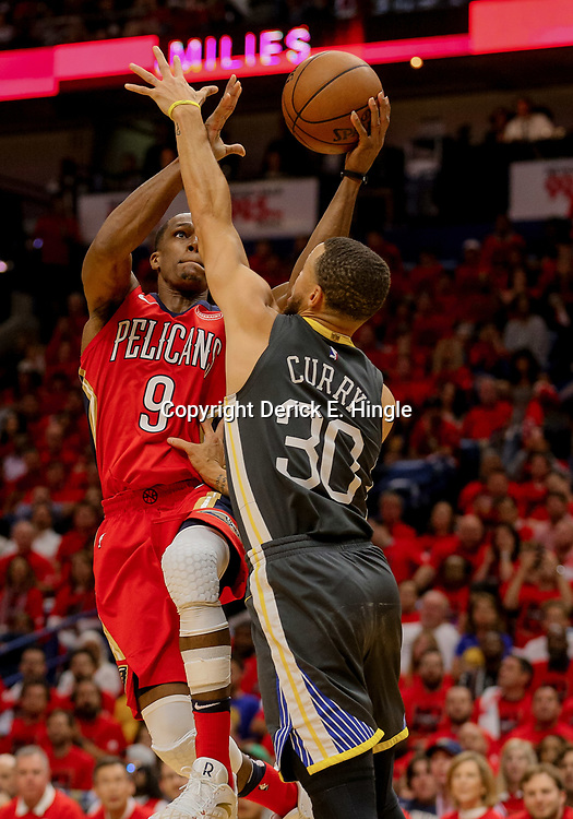 May 4, 2018; New Orleans, LA, USA; New Orleans Pelicans guard Rajon Rondo (9) shoots over Golden State Warriors guard Stephen Curry (30) during the third quarter in game three of the second round of the 2018 NBA Playoffs at Smoothie King Center. The Pelicans defeated the Warriors 119-100.  Mandatory Credit: Derick E. Hingle-USA TODAY Sports