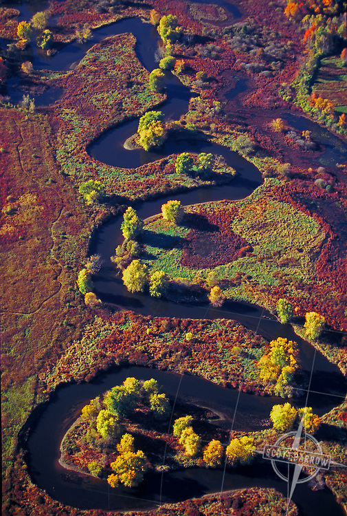 River winding through wetlands.