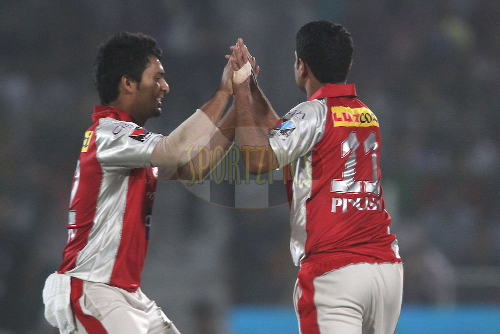 Piyush Chawla of the Kings XI Punjab is congratulated after getting Ashok Menaria of the Rajasthan Royals wicket during match 4 of the the Indian Premier League ( IPL) 2012  between The Rajasthan Royals and the Kings X1 Punjab held at the Sawai Mansingh Stadium in Jaipur on the 6th April 2012..Photo by Shaun Roy/IPL/SPORTZPICS