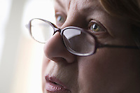Mature woman with reading glasses