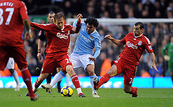 Carlos Tevez (Manchester City) Lucas and Javier Mascherano (Liverpool) during the Barclays Premier League match between Liverpool and Manchester City at Anfield - 21/11/09