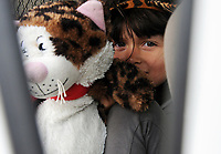 While her sisters play outside in the parking lot, Jenifer Garcia, 5, hides in the car behind her favorite toy.