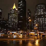 A Manhattan street scene at night time showing yellow taxi cabs. Manhattan, New York, USA. 26th March 2013. Photo Tim Clayton