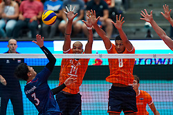 09-08-2019 NED: FIVB Tokyo Volleyball Qualification 2019 / Netherlands, - Korea, Rotterdam<br /> First match pool B in hall Ahoy between Netherlands - Korea (3-2) for one Olympic ticket / (L-R) Gyeong-Bok Na #3 of Korea, Nimir Abdelaziz #14 of Netherlands, Fabian Plak #8 of Netherlands