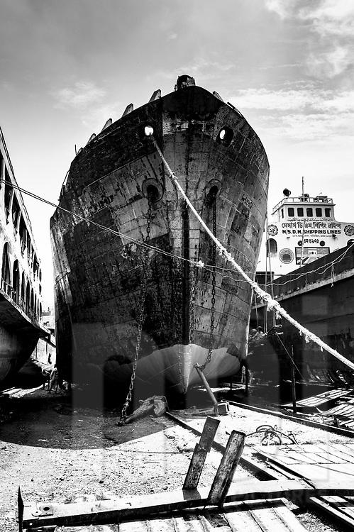Weathered ship docked in a shipyard of Dhaka, Bangladesh, Asia