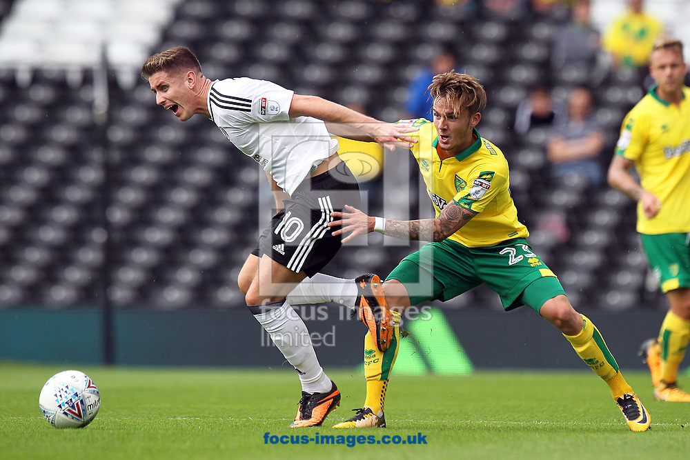 Tom Cairney of Fulham and James Maddison of Norwich in action during the Sky Bet Championship match at Craven Cottage, London<br /> Picture by Paul Chesterton/Focus Images Ltd +44 7904 640267<br /> 05/08/2017