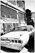Old Chevrolet in the street of old Al-Balad district in Jeddah, Saudi Arabia, black and white image