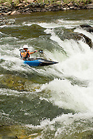 A kayaker paddles Tappen Falls (class 3-4 rapid).  Middle Fork of the Salmon River.  Frank Church-River of No Return Wilderness, Idaho.