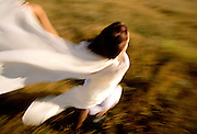 Woman in white running away, looking down