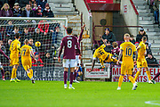 Marvin Bartley (#6) of Livingston FC scores a goal during the Ladbrokes Scottish Premiership match between Heart of Midlothian FC and Livingston FC at Tynecastle Park, Edinburgh, Scotland on 4 December 2019.