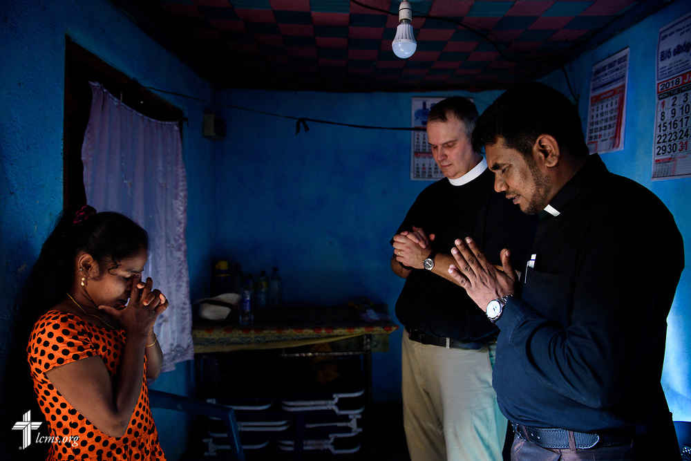 The Rev. P. Gnanakumar and the Rev. Steven Mahlburg, LCMS career missionary to Sri Lanka, visits a church member on the Eila rubber plantation in the Sabaragamuwa Province of Sri Lanka on Saturday, Jan. 20, 2018. LCMS Communications/ Erik M. Lunsford