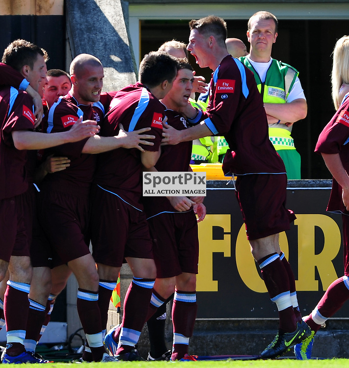 Stefan McCluskey (maroon, 10, centre) scores the first goal for Shotts..Auchinleck Talbot v Shotts Bon Accord, Emirates Junior Cup Final,  Sunday 27th May 2012..ALEX TODD | STOCKPIX.EU